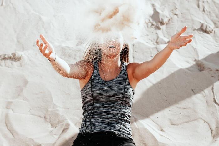 simple steps woman throwing sand honest