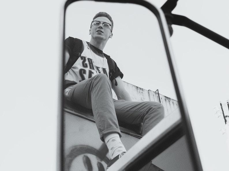 reflection of boy in mirror bw