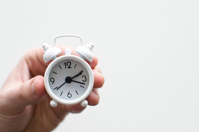 small white alarm clock