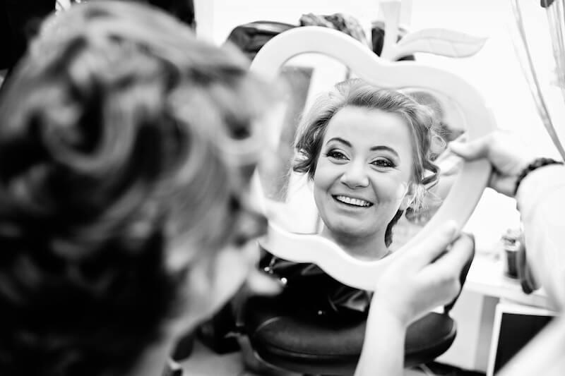 women smiling in mirror