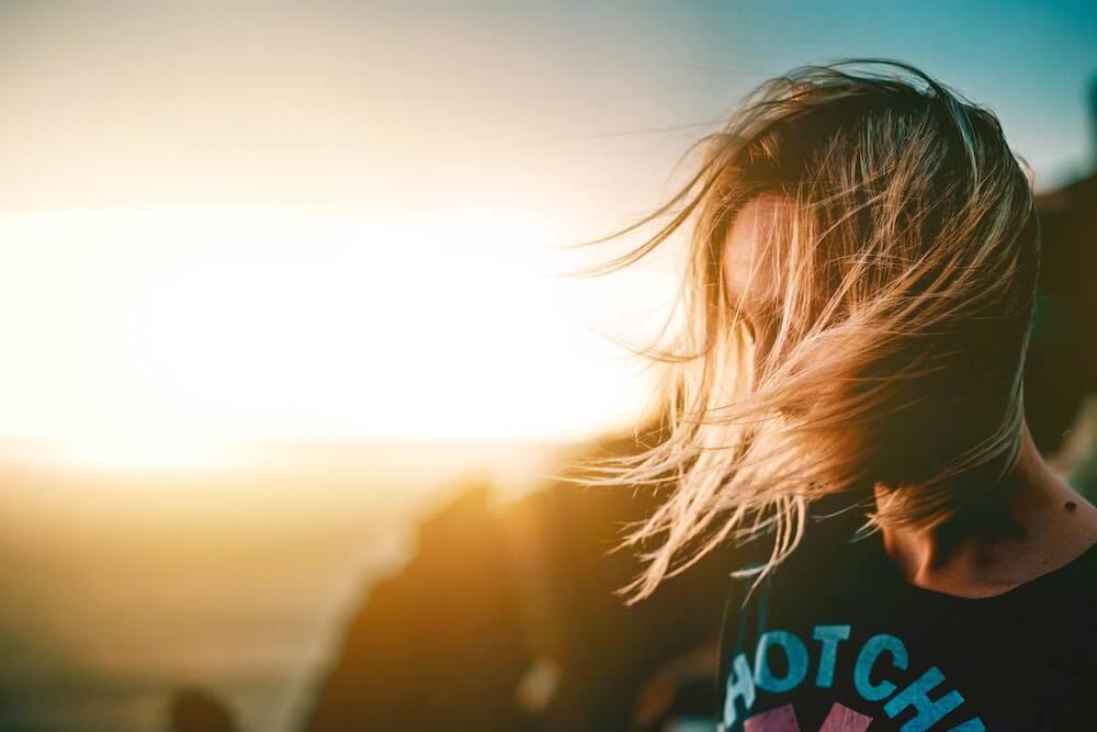 girl-hair-in-face-sunset