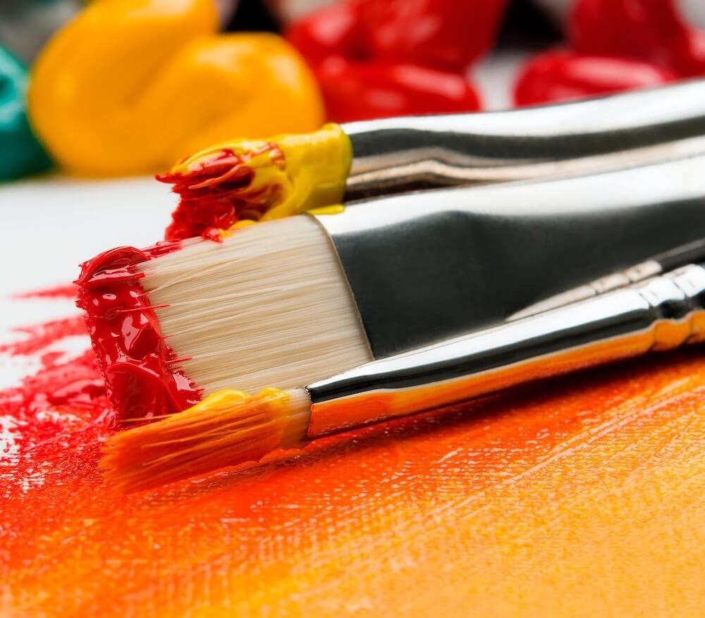 orange paint with brush