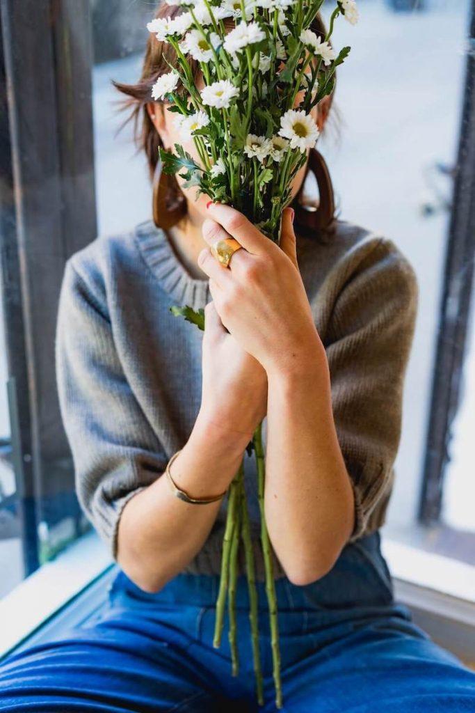woman-flower-in-face